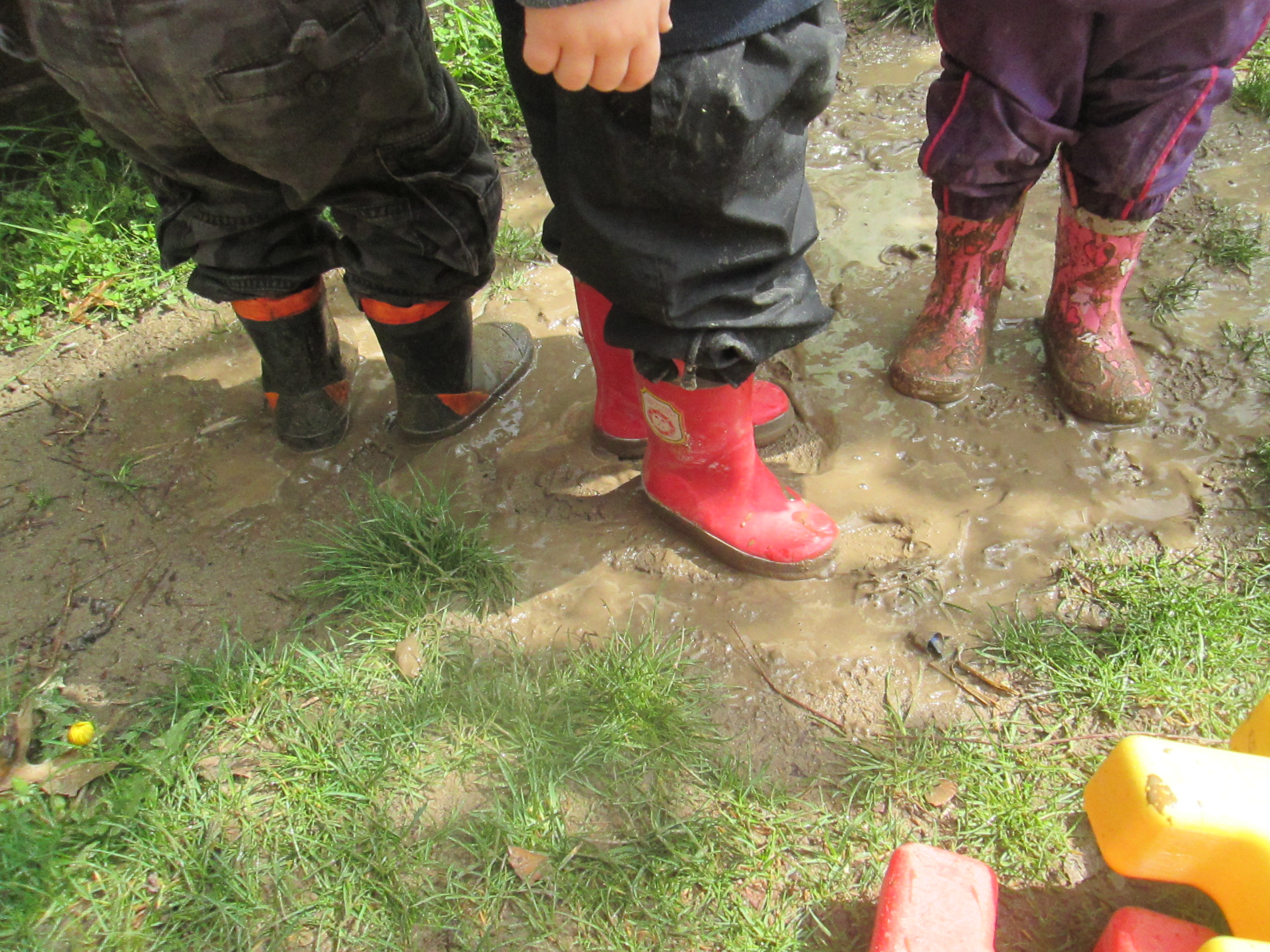 kids boots in the mud
